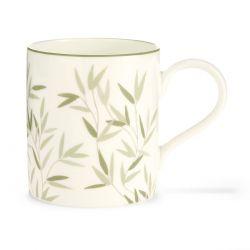 taza cerámica con hojas verdes