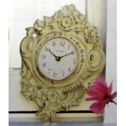 reloj de pared con decoración floral