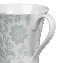 taza de flores azul y blanco