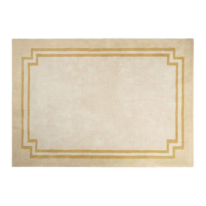 alfombra crema con cenefa dorada de diseño clásico y elegante