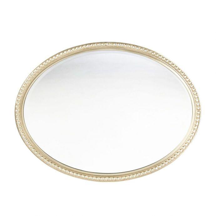 espejo ovalado champán con detalle de cuentas en el marco