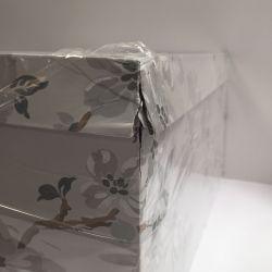 3 cajas estampadas con flores en tonos grises