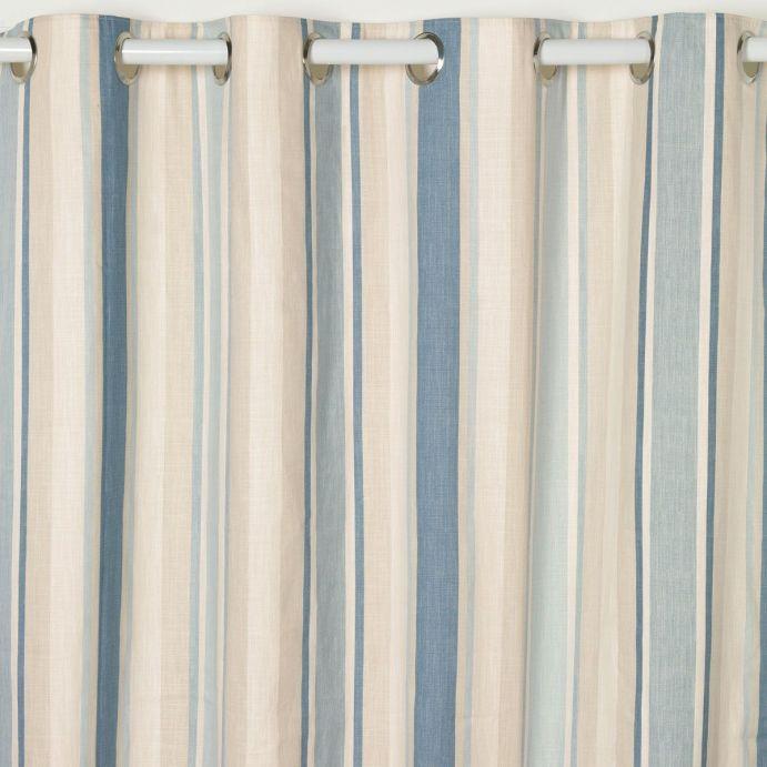 cortinas confeccionadas de ojales en rayas azul mar y hueso, de diseño