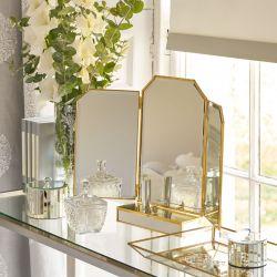 espejo de tocador dorado con cajón de diseño
