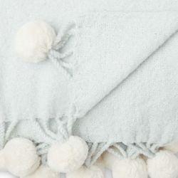 manta azul súper suave con pompones blancos de diseño