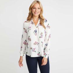 blusa marfil estampada con flores y detalle de lazada al cuello de diseño