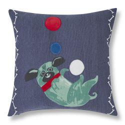 cojín azul tipo patchwork con perrito