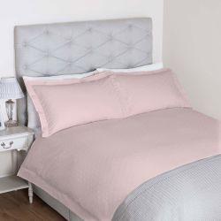 funda nórdica rosa con topos bordados de diseño