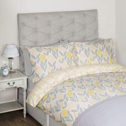 conjunto de ropa de cama con flores amarillas y grises de diseño
