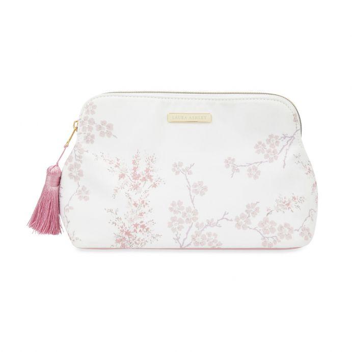 bolsa neceser estampado con flores rosas y blancas de diseño