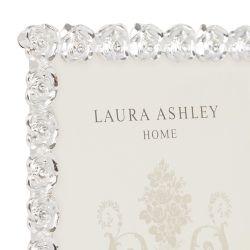 marco de fotos plateado con diseño de rosas