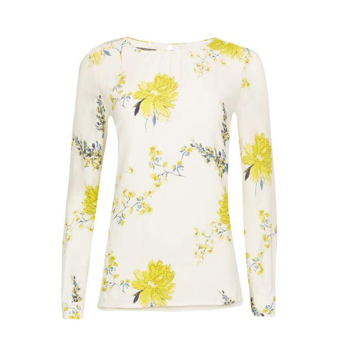 blusa blanca con flores amarillas diseño de doble capa