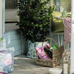 maceta de tela estampada con hojas tropicales de diseño