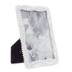 marco de fotos blanco con diseño de hojas