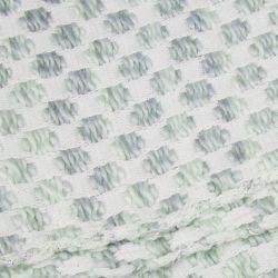 manta gris verdoso de lunares con flecos de diseño