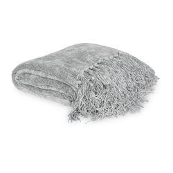 manta gris de diseño con flecos perfecta para sofá