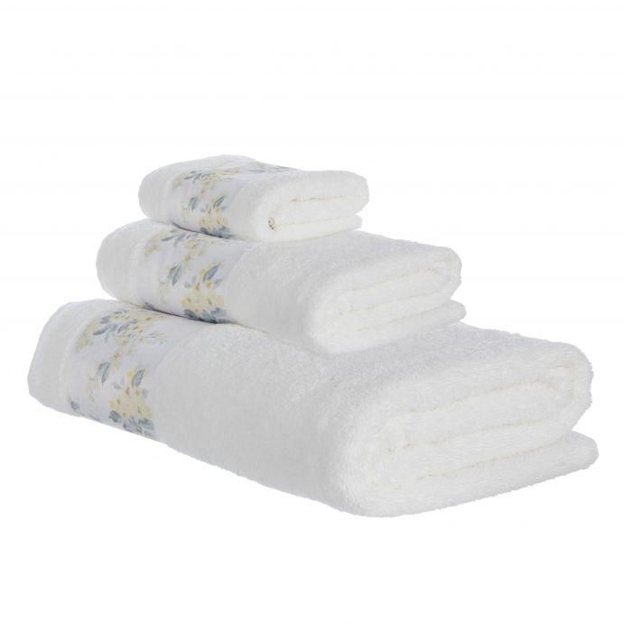 toallas blancas con cenefas de flores amarillas de diseño