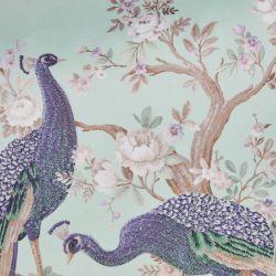 cojín con pavos reales sobre fondo azul verdoso de diseño