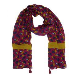 Bufanda estampada con borlas en las esquinas.