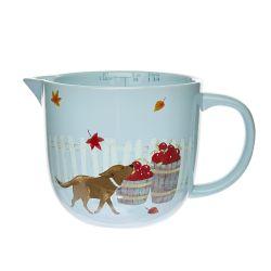 jarra medidora cerámica con pico para servir de diseño en azul con perro hojas y manzanas