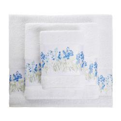 toallas blancas con cenefa de flores azules de diseño