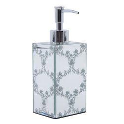 dispensador de jabón espejado y flores