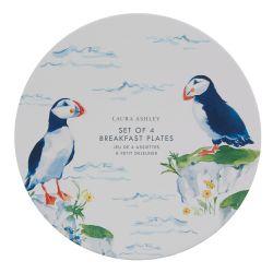4 platos de postre con pequeños pájaros frailecillos estampados en el borde