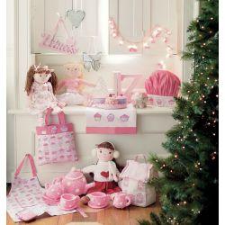 tarta de juguete en fieltro rosa y blanco en porciones