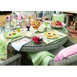 mesa de comedor de ratán con tapa de cristal de diseño