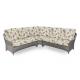 sofá esquinero para jardín de ratán con cojines de estampados florales de diseño