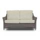 sofá de ratán de diseño con textiles estampados esclusivos para jardín
