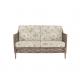 sofá para jardín en ratán color roble con cojines estampados de diseño