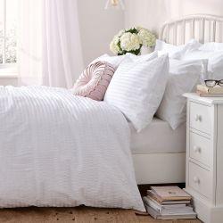 conjunto de ropa de cama blanco textura diseño