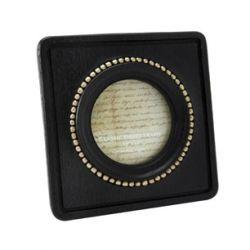 marco negro de apertura circular con remates dorad