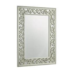 elegante espejo de acabado champán y marco de diseño intrincado