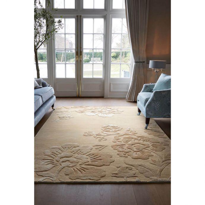 alfombra con flor color natural en ambiente