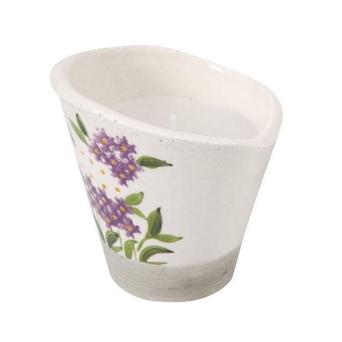 vela en maceta cerámica
