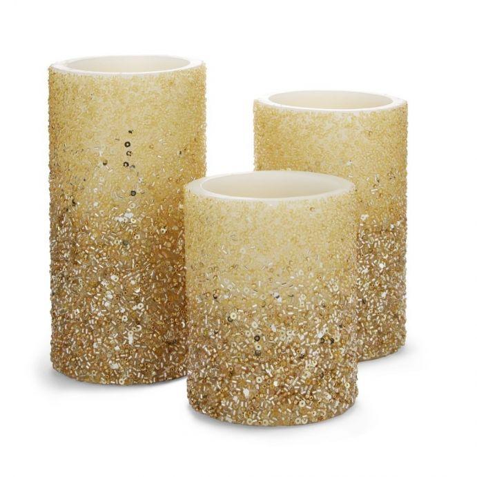 conjunto de 3 velas decoradas en oro