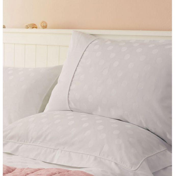 funda nórdica blanca para cama con diseño de topos jarquard