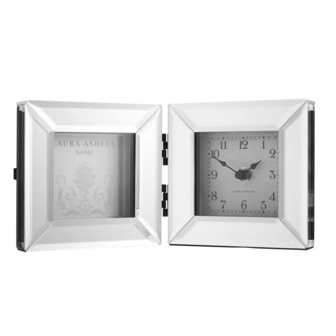 reloj y marco espejado Block